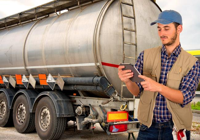 Fuel truck driver with tablet